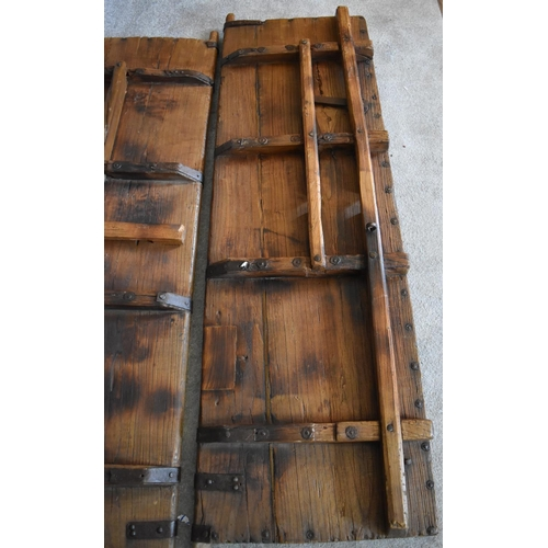 1 - A pair of large antique metal bound oak doors. H.196 x 59cm...