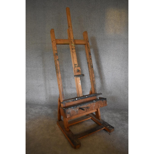 99 - An adjustable and articulated beech framed  professional artist's easel. H. 193 x 74cm (Property of ...