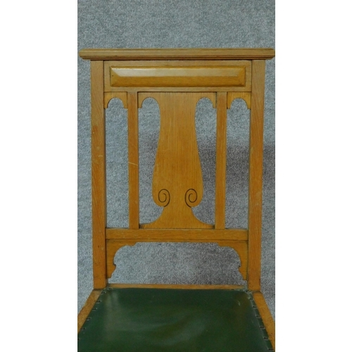 4 - A set of four Art Nouveau oak chairs with carved back and green leather upholstery raised on square ...
