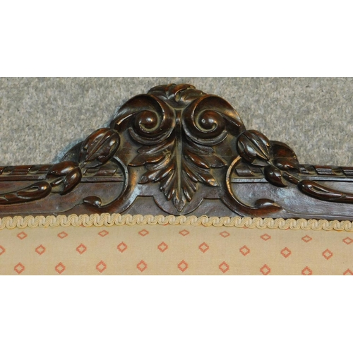 5 - A Victorian carved mahogany framed open arm two seater sofa on turned tapering supports. H.104 W. D....