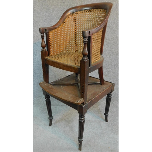 6 - A Georgian mahogany child's bergere armchair on base with reeded swept supports. H.91cm...
