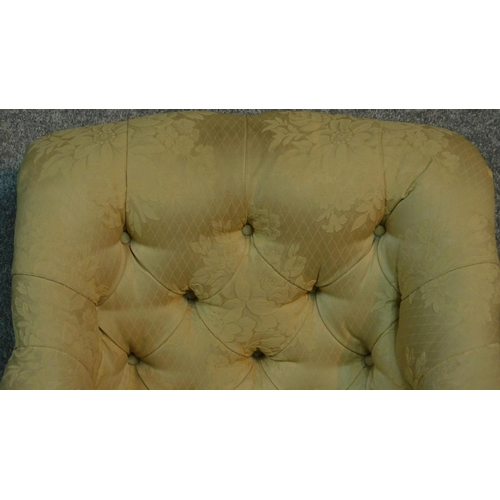 9 - A Victorian armchair with cream and floral upholstery, raised on turned tapering supports. H.87cm...