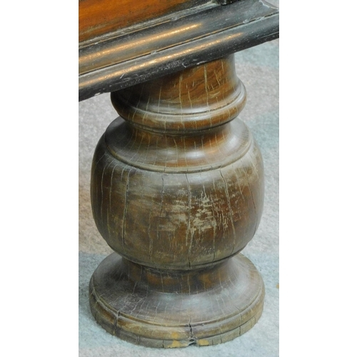 10 - A 19th century Continental cassone with fret cut brass escutcheon, hinged candle box on bulbous turn...