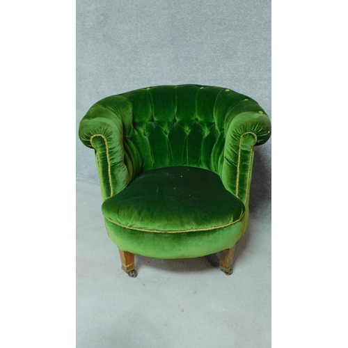 11 - A pair of Victorian mahogany framed buttoned back tub armchairs on turned tapering supports. H.72cm...
