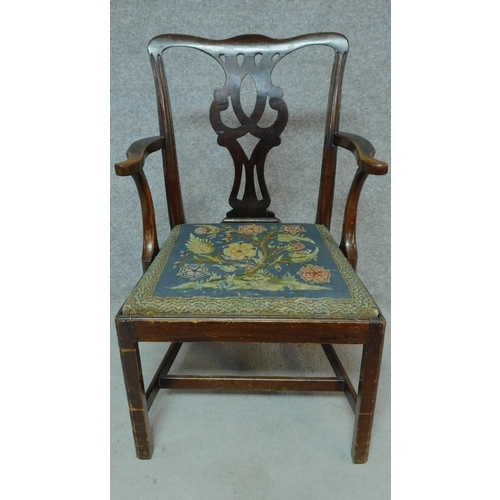 12 - A Georgian mahogany open armchair with drop in tapestry seat on square tapering supports. H.94cm...