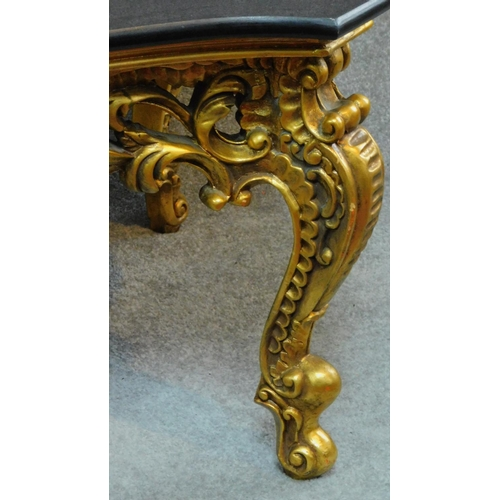 31 - A gilt Rococo style coffee table with shaped marble top. H.47 W.139 D.79cm...