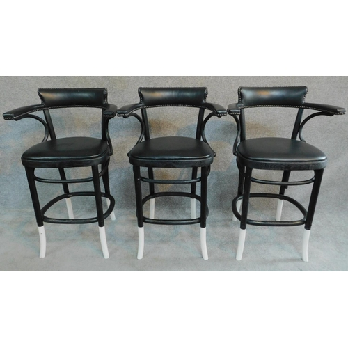 32 - A set of three ebonised bentwood style bar chairs. H.98cm...