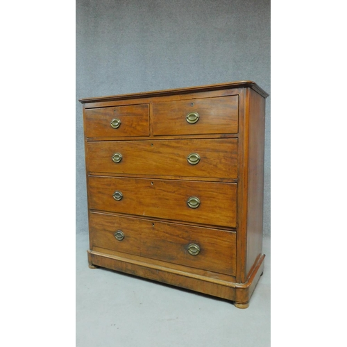 36 - An Edwardian mahogany chest of two short over three long drawers raised on pebble feet. H.123 W.122 ...