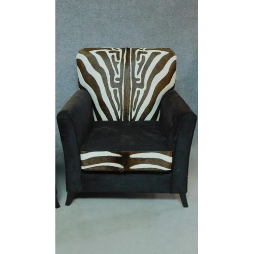 37 - A pair of contemporary pony skin zebra print and black fabric armchairs, by Ninas House. H.92cm...