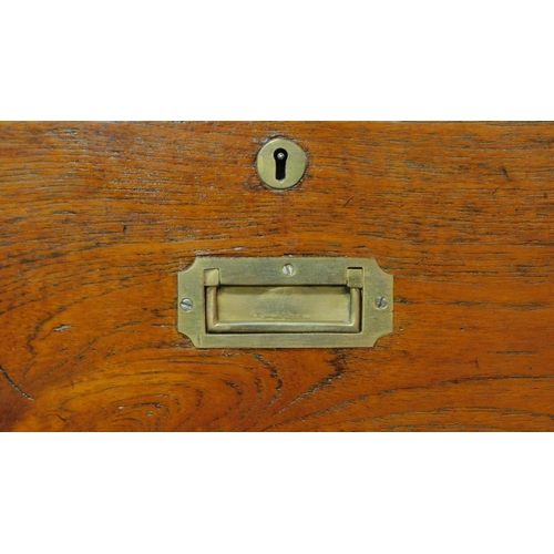 38 - A 19th century teak two part brass bound military campaign chest fitted inset brass handles. H.98 W....
