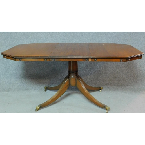 39 - A Regency style mahogany dining table raised on fluted swept quadruped supports. H.79 W.169 D.84cm...