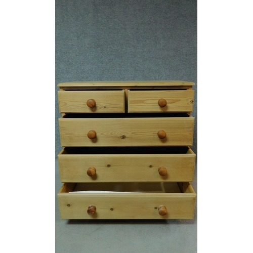 40 - A pine chest of two short over three long drawers. H.92 W.92 D.47cm...