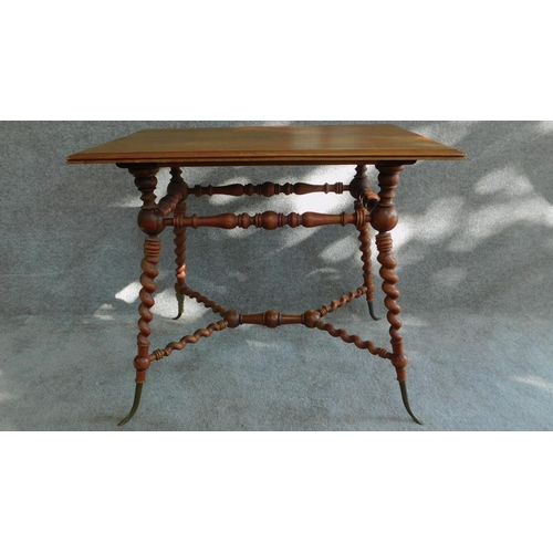 18 - A Victorian walnut occasional table on turned and spiral twist stretchered base on swept brass cappe...
