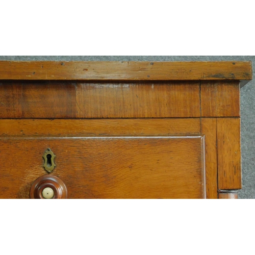 19 - A Victorian oak and mahogany chest of two short over three long drawers flanked by pilasters raised ...