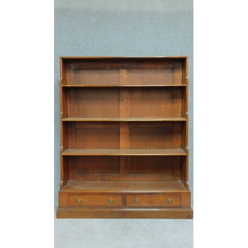 20 - A Georgian mahogany open waterfall bookshelf fitted with two base drawers. H.133 W.107 D.30cm...