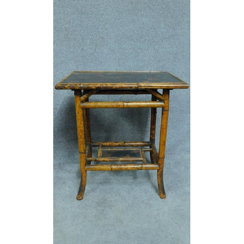 47 - A late 19th century bamboo bedside table with floral red and black lacquered top and one drawer toge...