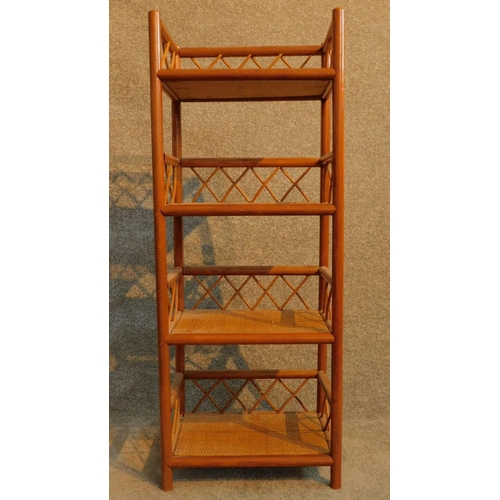 52 - A 20th century teak and rattan whatnot. H.96 W.38 D.25cm...