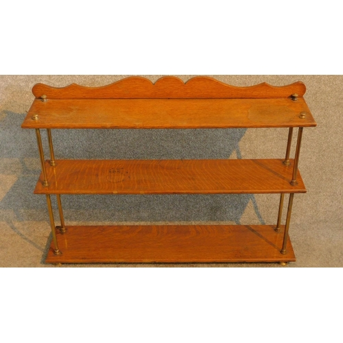 23 - A set of Victorian oak open shelves with brass supports and feet. H.63 W.89 D.20cm...
