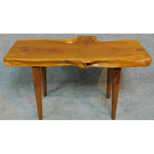 54 - A vintage natural form yew wood bench by Reynolds of Ludlow. H.40 W.74 D.37cm...