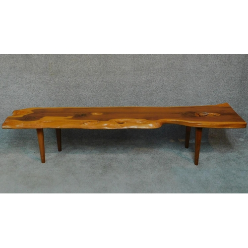 55 - A Vintage natural form yew wood coffee table by Reynolds of Ludlow. H.40 W.104 D.43cm...