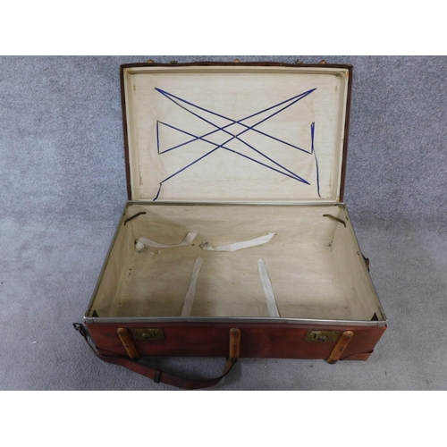 58 - A vintage leather and wood steamer trunk. H.34 W.84 D.54cm...