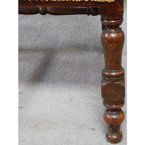 26 - A Victorian oak chair with floral carving to the back and woven peacock feather design upholstery ra...