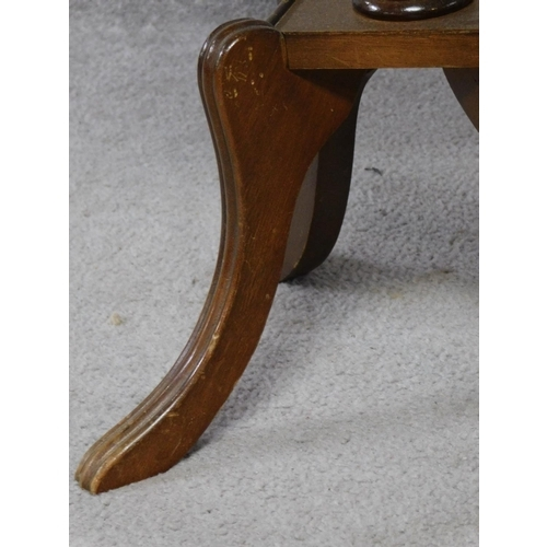 59 - An Edwardian mahogany wine table with shell inlay raised on quadruped swept supports. H.55cm...