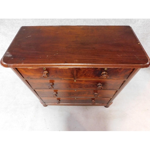 27 - A Victorian mahogany chest of two short over three long drawers, raised on squat turned supports. H....