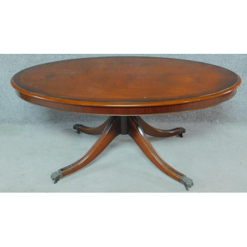 33 - A Regency style mahogany low table raised on turned swept legs on casters. H.54 W.125 D.72cm...