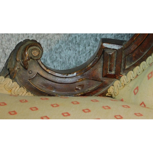 4 - A Victorian carved mahogany framed open arm two seater sofa on turned tapering supports. H.104 W. D....