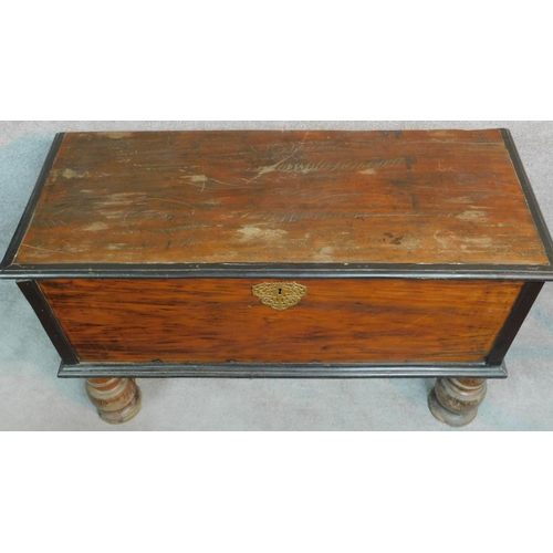 8 - A 19th century Continental cassone with fret cut brass escutcheon, hinged candle box on bulbous turn...