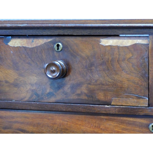 13 - A Victorian mahogany chest of two short over three long drawers, raised on squat turned supports. H....