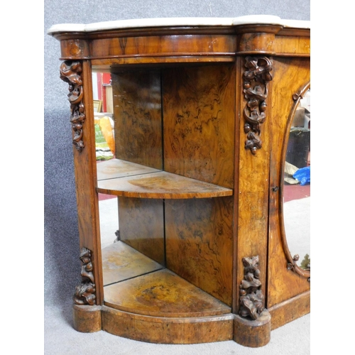 14 - A 19th century marble topped and mirrored burr walnut credenza with floral carvings on shaped plinth...
