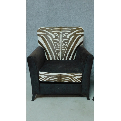 36 - A pair of contemporary pony skin zebra print and black fabric armchairs, by Ninas House. H.92cm...