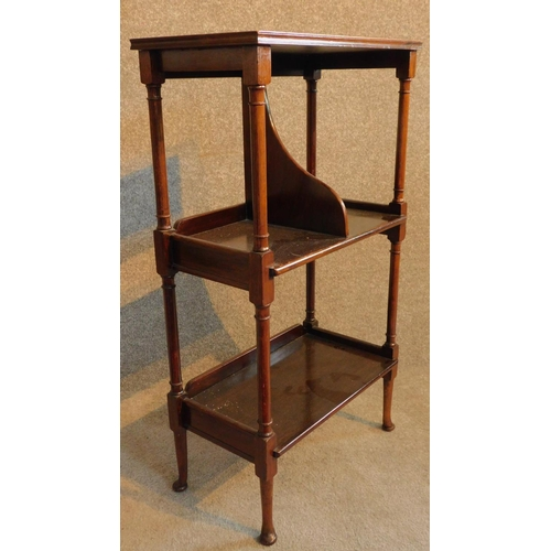 42 - An Edwardian mahogany whatnot fitted with folio divider on cabriole supports. H.86 W.48 D.27cm...
