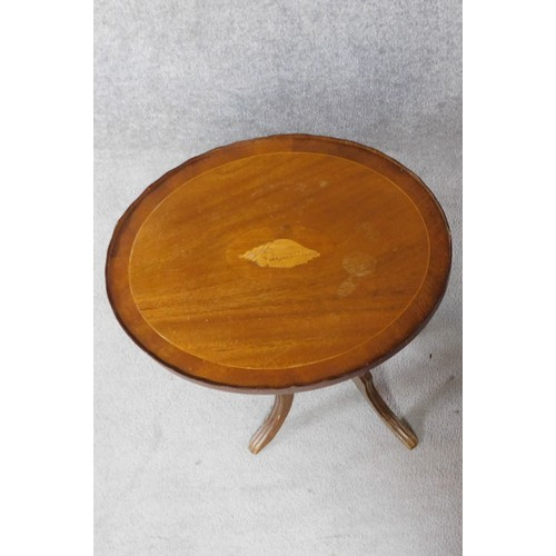 47 - An Edwardian mahogany wine table with shell inlay raised on quadruped swept supports. H.55cm...