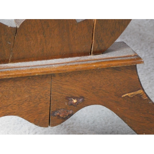 48 - A Regency style mahogany drop flap sofa table with two dummy drawers opposing a pair of drawers. Rai...