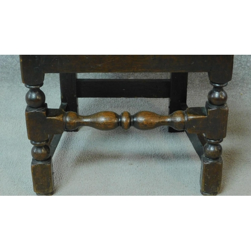1 - A near pair of antique country oak chairs raised on stretchered turned supports. H.103cm...