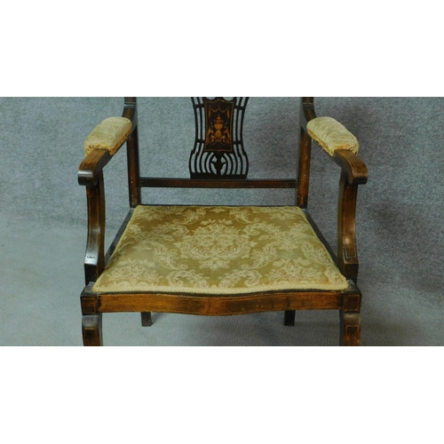 16 - A late Victorian mahogany and satinwood inlaid armchair with urn design to the back, floral upholste...