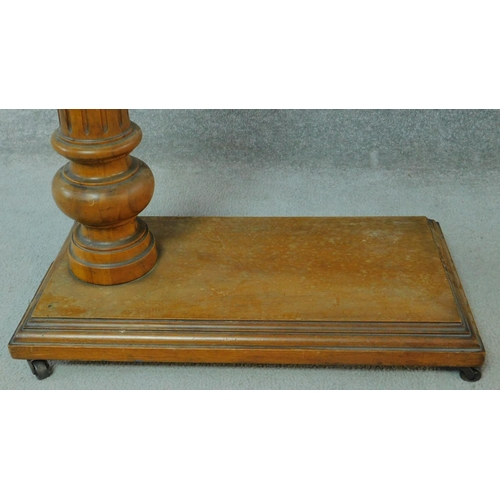 19 - A 19th century mahogany adjustable and tilting reading stand on fluted support on platform catered b...