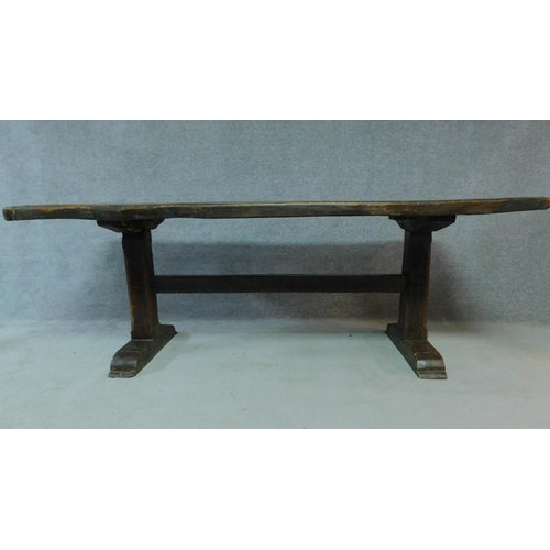 3 - An antique country oak refectory dining table on stretchered platform support. H.76 W.213 D.82cm...