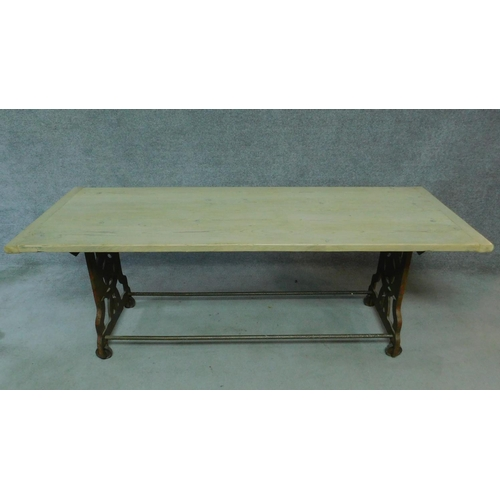 54 - An early 20th Century pine dining table with industrial style metal base. H.65 W.200 D.70cm...