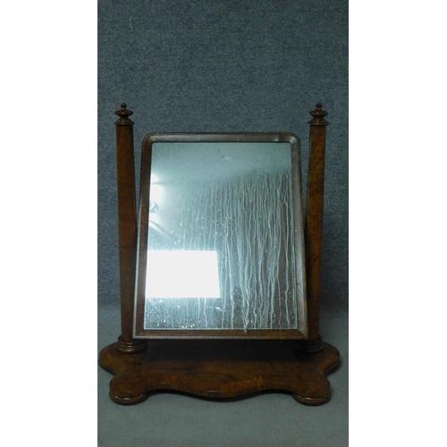 25 - A Victorian burr walnut adjustable toilet mirror. H.84 W.80cm...
