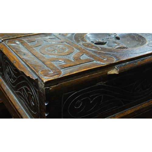 26 - A late 19th Century oak writing desk with floral carving and bobbin turned supports. H.70 W.66 D.42c...