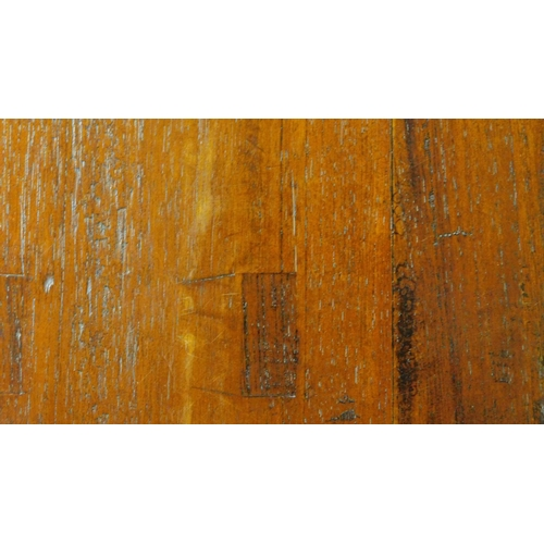56 - A early 20th Century teak refectory dining table raised on square tapering supports. H.78 W.250 D.94...