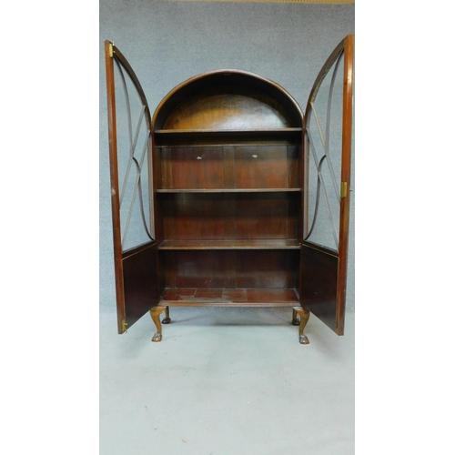 59 - A mid 20th century Art Deco style mahogany bookcase, astragal glazed section above panel doors raise...