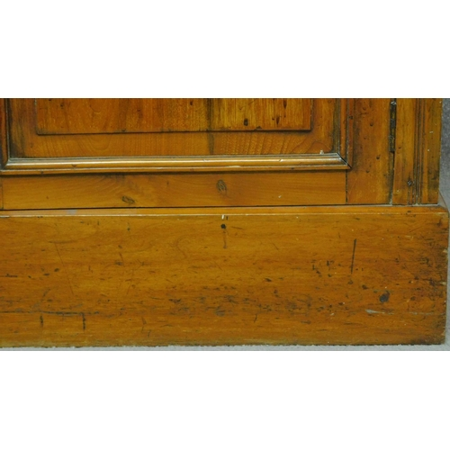 28 - A Victorian oak library bookcase, the upper glazed section above panelled doors on plinth base. H.20...