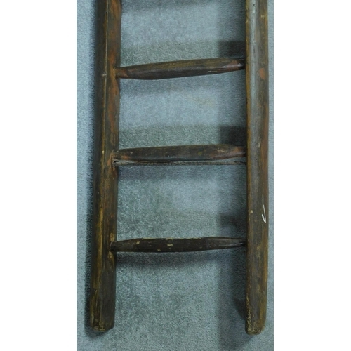 30 - An antique oak ladder. H.325cm...