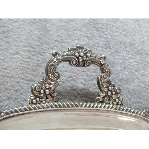 16 - A Victorian silver two handled tray. Hallmarked CE & Co for Charles Ellis & Co, Sheffield, 1899. Eng...