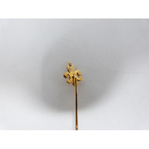44 - Two antique yellow metal tie pins with three Victorian gold brooches. One tie pin in the form of a b...